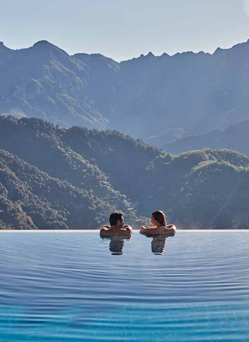 belmond caruso couple in infinity pool